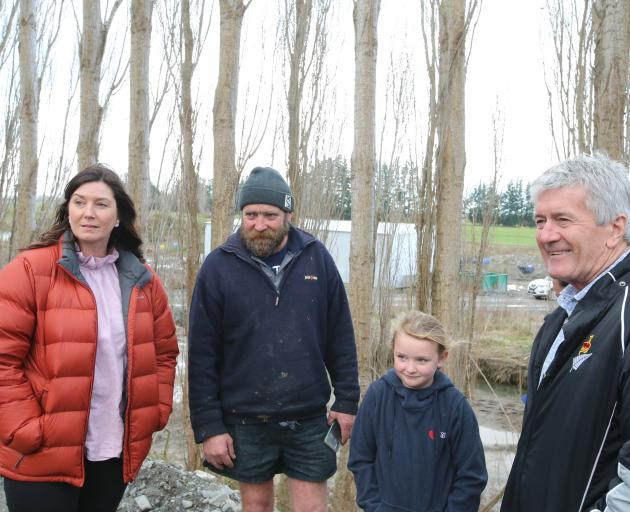 Rangitata MP Jo Luxton, Laurence Rooney, Honer Rooney (7) and Agricultural Minister Damien O'Connor at the Rooney Farm yesterday. PHOTO: LDR / ADAM BURNS