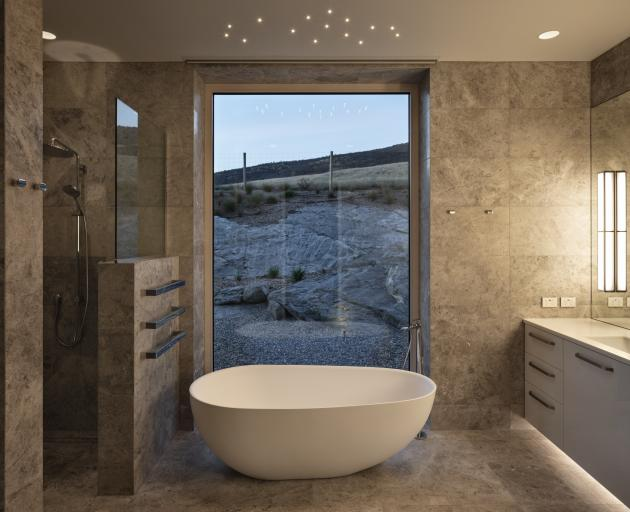 Marble and glass give the master bedroom en-suite a simple but sophisticated feel.