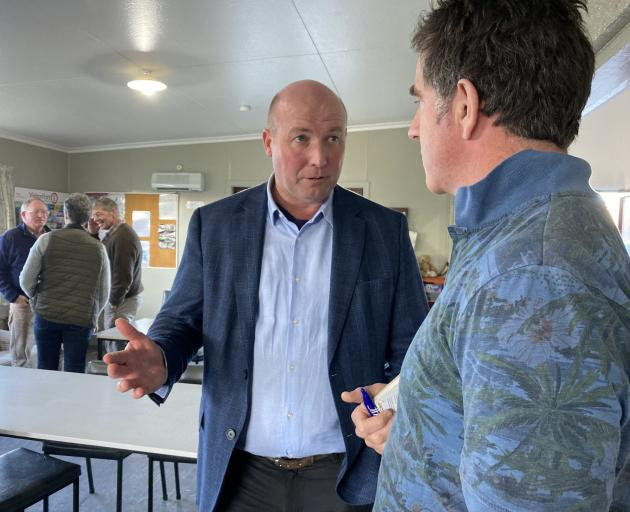National Party spokesman for agriculture and horticulture David Bennett speaks with a farmer at a...