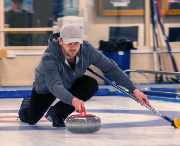 Scott Becker prepares to release his stone at the New Zealand Mixed Doubles Curling Competition...