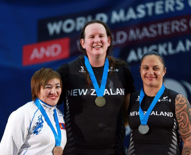 New Zealand's Laurel Hubbard (centre) won a gold medal competing in the ...