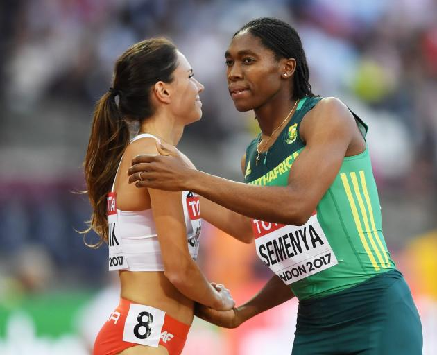 Caster Semenya, of South Africa, and Joanna Jozwik, of Poland, shake following  an 800m heat  at...
