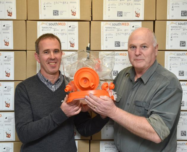 Mark Seaton (left) and Richard Aimers, of SouthMED Ltd, display one of their ventilator hoods,...