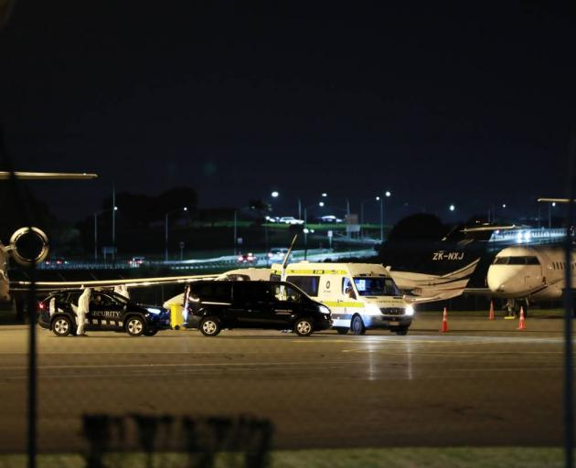A plane believed to be carrying a Covid-19 positive person from Fiji arrived at Auckland Airport on Thursday evening. Photo: Hayden Woodward