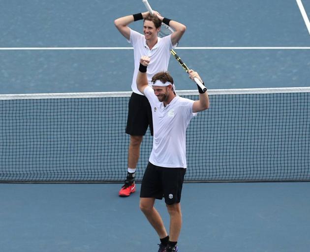 Marcus Daniell and Michael Venus celebrate winning the bronze medal match against Tennys Sandgren and Austin Krajicek. Photo / Getty Images