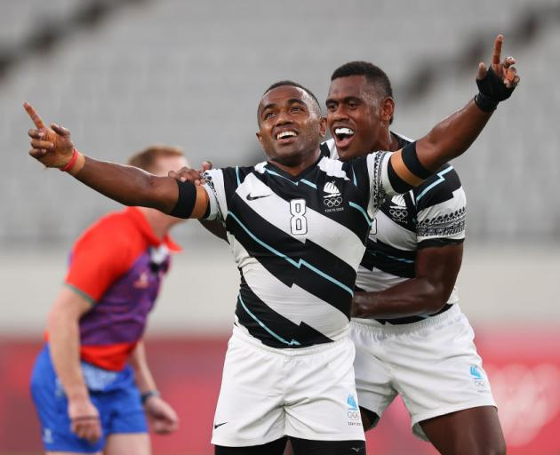 Waisea Nacuqu celebrates after winning the Rugby Sevens Men's Gold Medal match against New Zealand. Photo: Getty Images