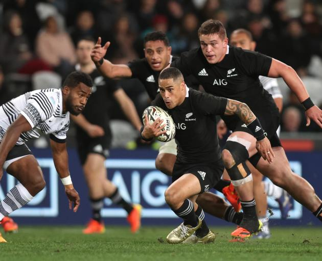 Aaron Smith looks to break against Fiji at Forsyth Barr Stadium. Photo: Getty Images