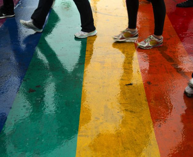 A rainbow-painted pedestrian crossing in Toronto. PHOTO: GETTY IMAGES