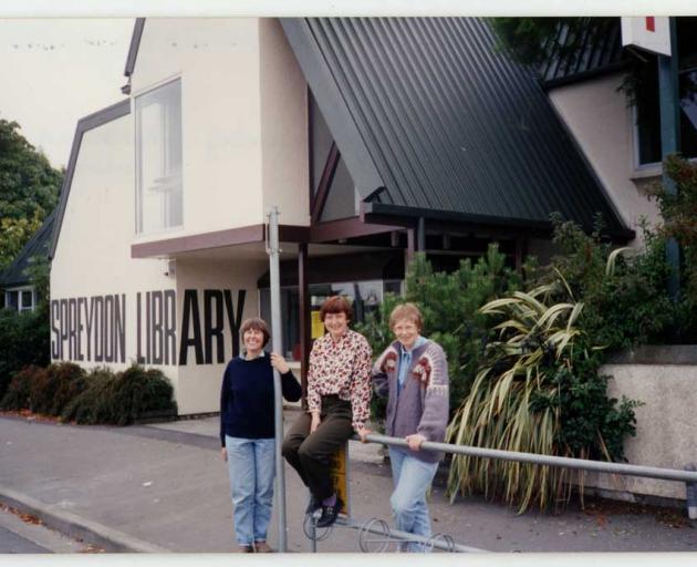 Library assistants Barbara Moorhouse, Kim Slack, and Hilary Renfree outside Spreydon Library when...