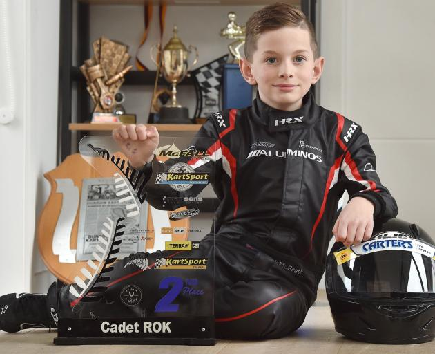 Kart racer Jack McGrath (9), of Mosgiel, with the second-place trophy he won at the national...