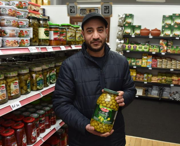 Mohamed Alomar stands in his new Arabic supermarket that will open on Monday. PHOTO: GREGOR...
