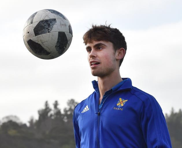 Otago University midfielder Oban Hawkins watches the ball at Logan Park Turf yesterday before...