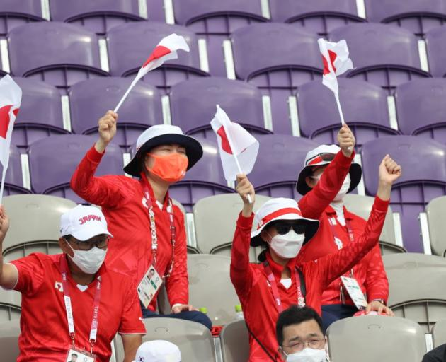 Spectators for Team Japan cheer during the Men's Team semi-finals. Photo: Getty Images