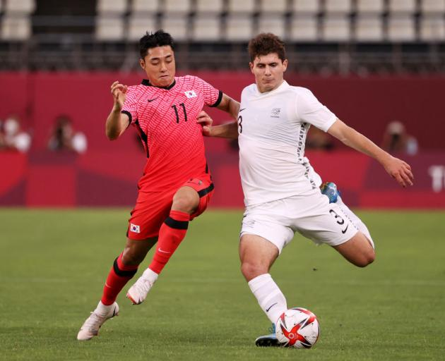 Liberato Cacace of Team New Zealand is challenged by Dongjun Lee of Team South Korea during the Men's First Round Group B match. Photo: Getty Images
