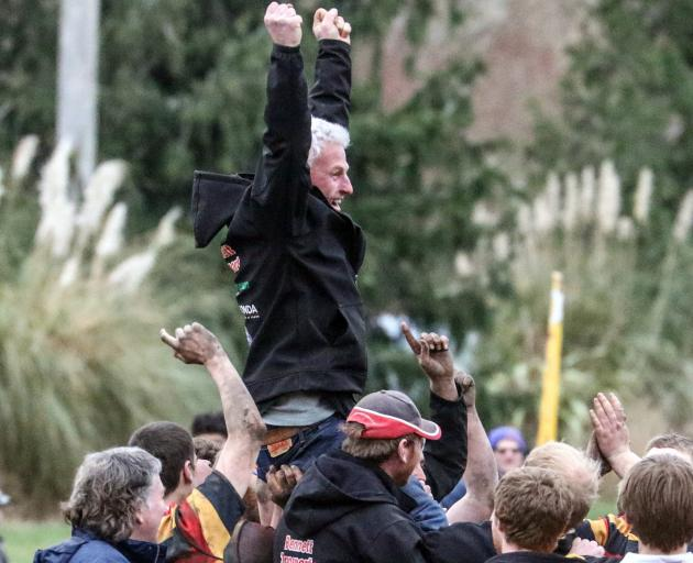 Union rugby coach Peter Stackhouse is hoisted aloft by players and supporters after the North...