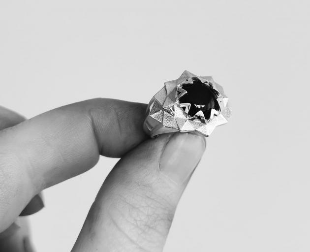 Star Ring, featured in sterling silver, set with a black onyx stone. A timeless classic and the...