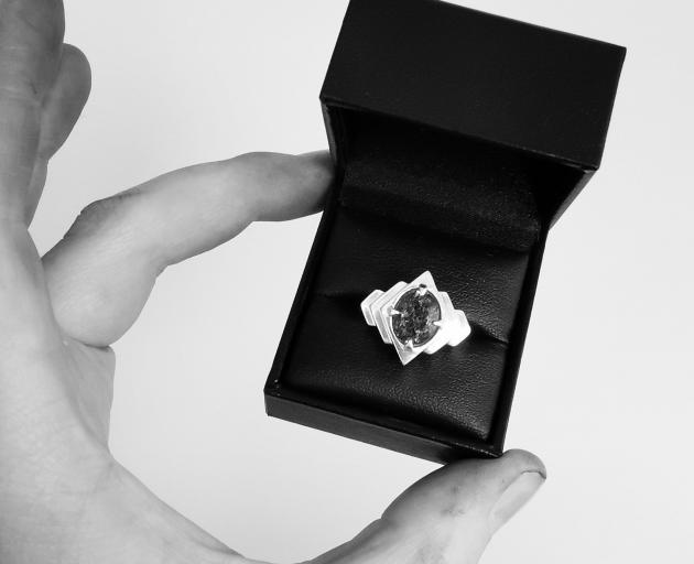 Echo Cocktail Ring; the tourmalinated quartz stone is held in radiating waves of geometrically...