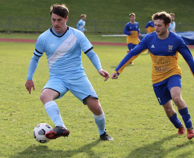 Royals midfielder Olivier Cassidy (left) takes on Ben Deeley (Otago University) at the Caledonian...