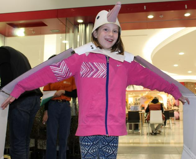 Wearing wings to experience the three-metre wingspan of a Northern Royal Albatross is Miriam...