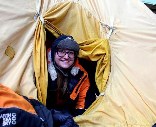 Far From Frozen venue co-ordinator Jessica Davis demonstrates the type of clothing and tent...