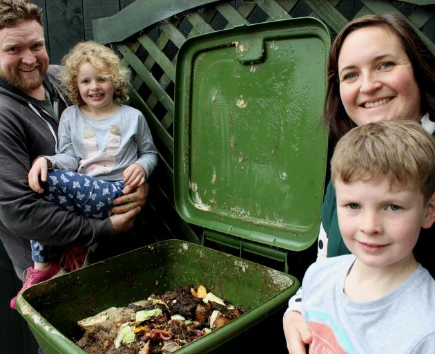 Belleknowes family Brendan Warren with daughter Eadie (6) and Laura Warren with son Toby (8) feed...