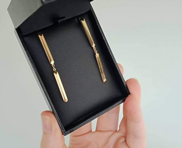 Customised Parallel Stud earrings draw from architecture, inspired by pillars. Made from gold...