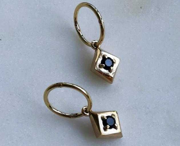 Set Diamond Hoops are made of sterling silver, plated in gold and set with black spinel. These...