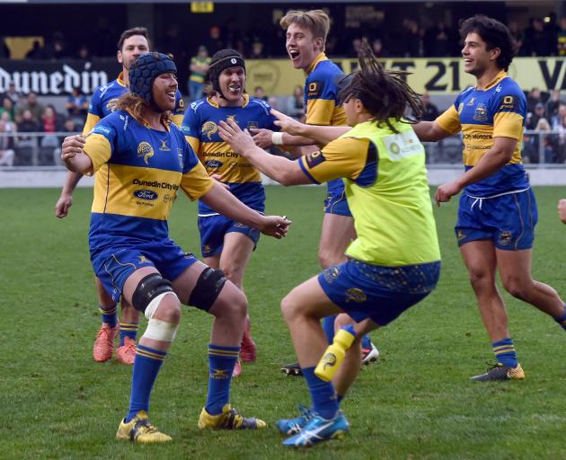 Taieri celebrate their win over Green Island in the Dunedin Premier rugby final at Forsyth Barr...