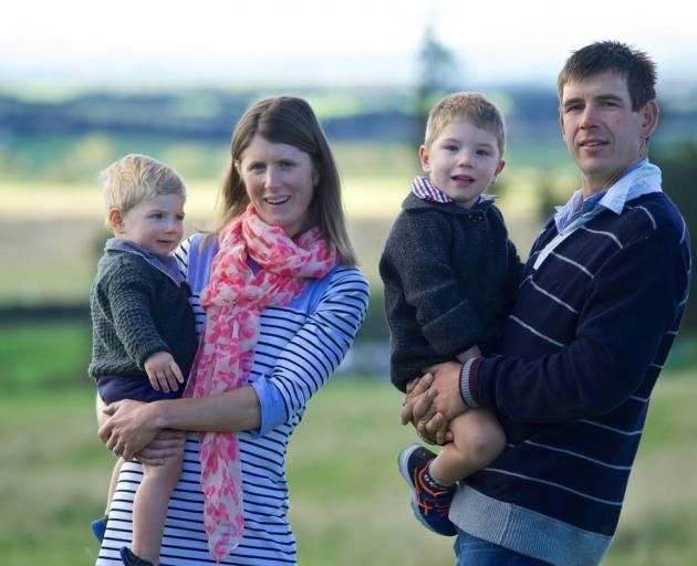 Nadine Tomlinson with husband Scott and sons Sam (left) and Angus. Photo: supplied