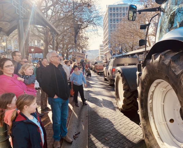 A convoy of farm vehicles heads through the Octagon. Photo: Craig Baxter