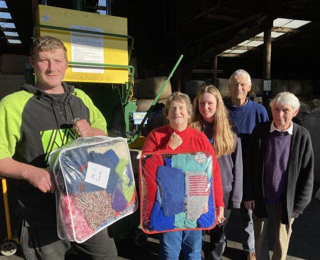 Operation CoverUP volunteers visit Taieri Wool & Skins near Mosgiel on Monday to bale up a giant...