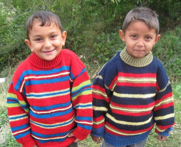 A pair of Romanian children wear warm woollen jumpers donated through Operation Cover Up. PHOTO:...