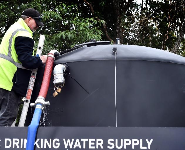 Filling up a water tank in Kildare St, Waikouaiti, this week is Steve Barnes, of Dynes Transport....