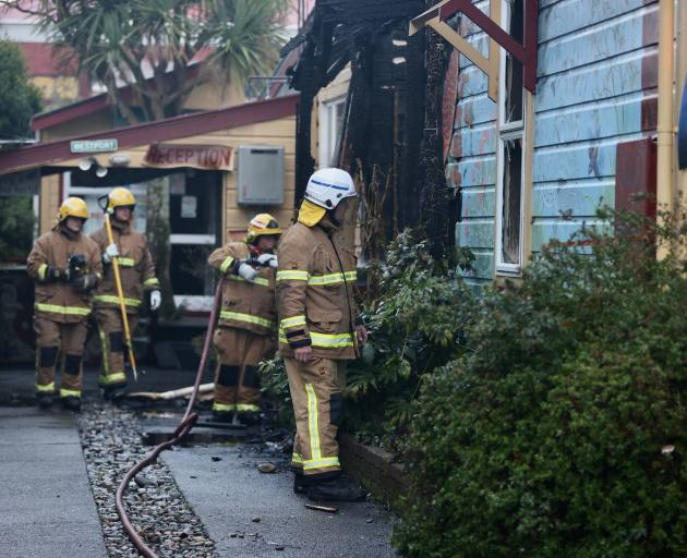 Firefighters at the scene of a house fire in Westport. Photo: NZ Herald