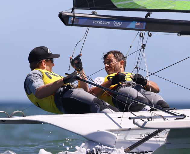 Peter Burling and Blair  Tuke sail to silver in the men's 49er class.