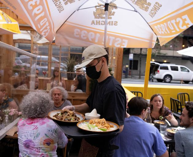 Food is served to diners at a restaurant in Manhattan, New York. Photo: Reuters