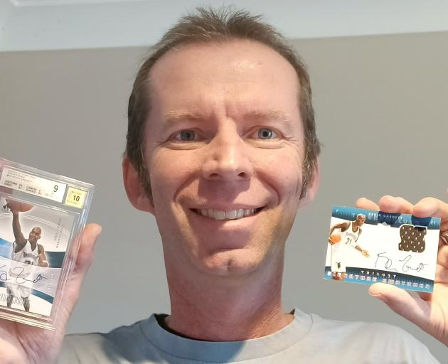 Alistair Banks shows off two of his autographed Kevin Garnett trading cards. PHOTO: MALIA BANKS