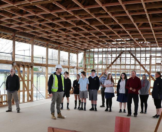 Lawrence Area School rebuild contractors Naylor Love show senior pupils and staff the progress made on new classrooms and facilities during a recent tour. PHOTO: JOHN COSGROVE