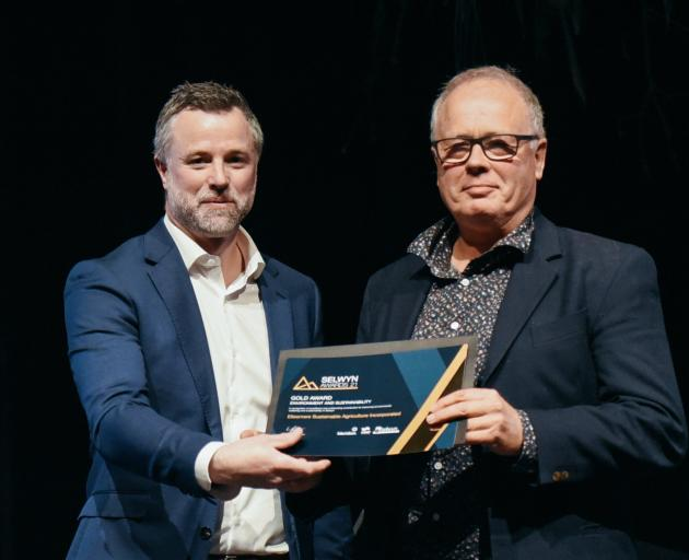 Ellesmere Sustainable Agriculture Inc chairman Tim Chamberlain (right) receives the Environment...