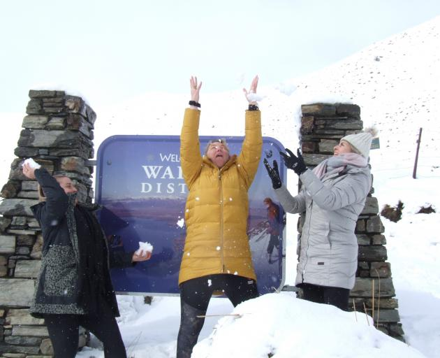 Having fun in the snow at the summit of the Lindis Pass yesterday afternoon were Allanah Kelly...