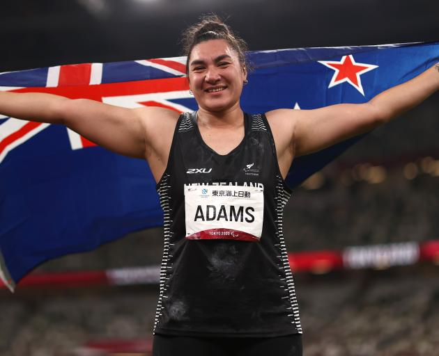 New Zealand shot putter Lisa Adams celebrates after winning gold at the Tokyo 2020 Paralympic...
