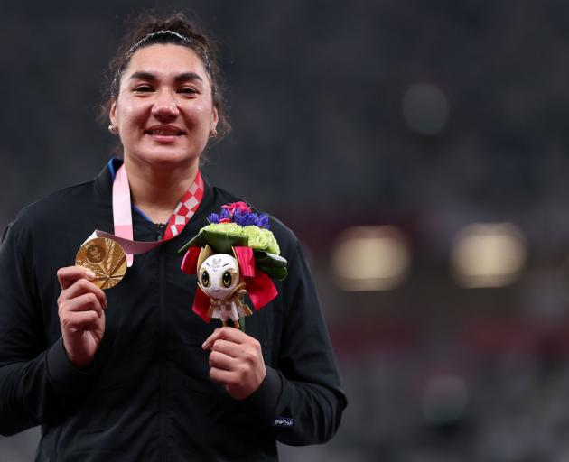Lisa Adams of Team New Zealand celebrates with the gold medal during the medal ceremony after winning the Women's Shot Put - F37 Final. Photo: Getty Images
