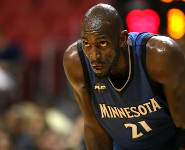 Garnett looks on during one of his final games for the Minnesota Timberwolves. PHOTO: GETTY IMAGES