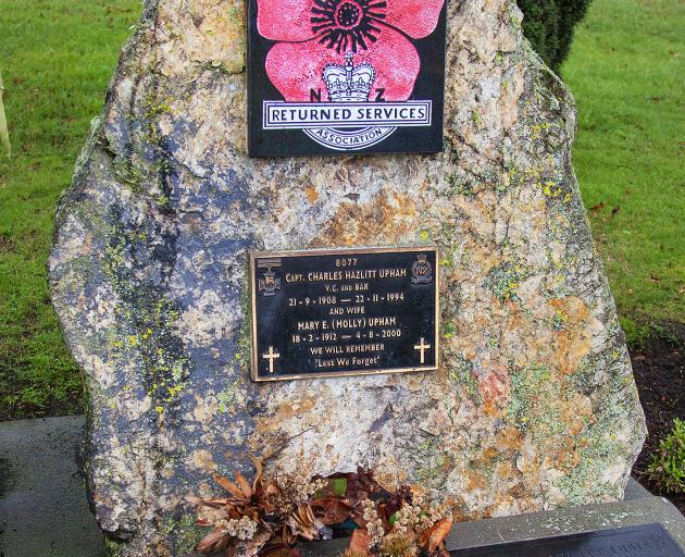Army volunteers also spruced up the Upham grave at St Paul's Anglican church. Photo: Geoff Sloan