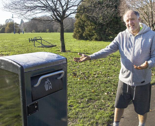 Andrew Meads with one of the new BigBelly bins installed at Hansen Park. Photo: Geoff Sloan