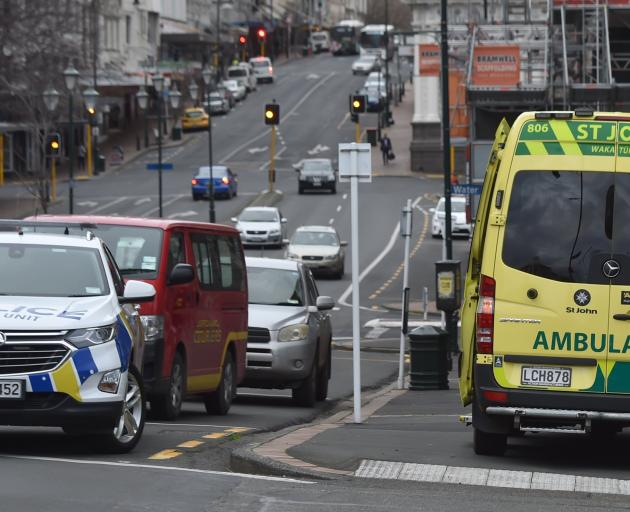 Emergency services at the scene in Princes St this afternoon. Photo: Peter McIntosh