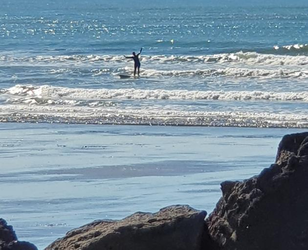 BUSTED: This surfer rides against the tide of public opinion - in Sumner - during the Covid-19...
