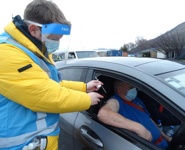 Evan Johnston, of Kingston, gets a Covid-19 vaccination from Brendon McIntosh at the Queenstown...