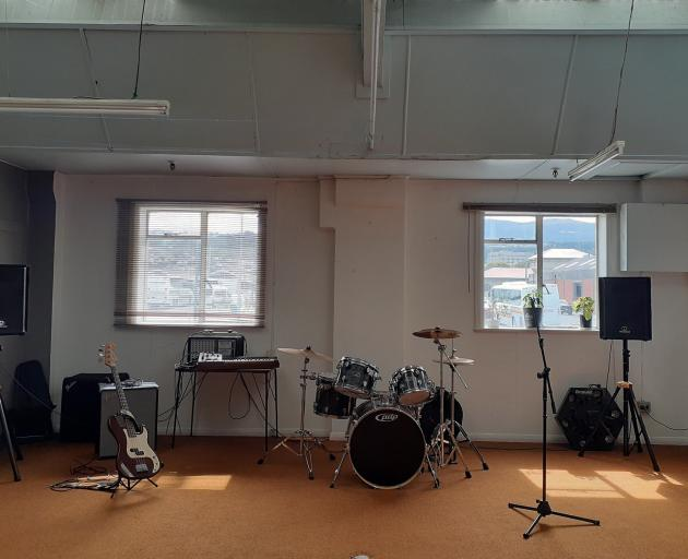 A practice room in Spaceland. Below, the inaugural gig. PHOTOS: SUPPLIED
