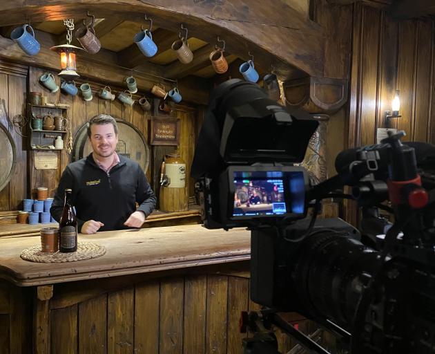 Hobbiton Movie Set Tours deputy chief executive Shayne Forrest serves at The Green Dragon tavern...